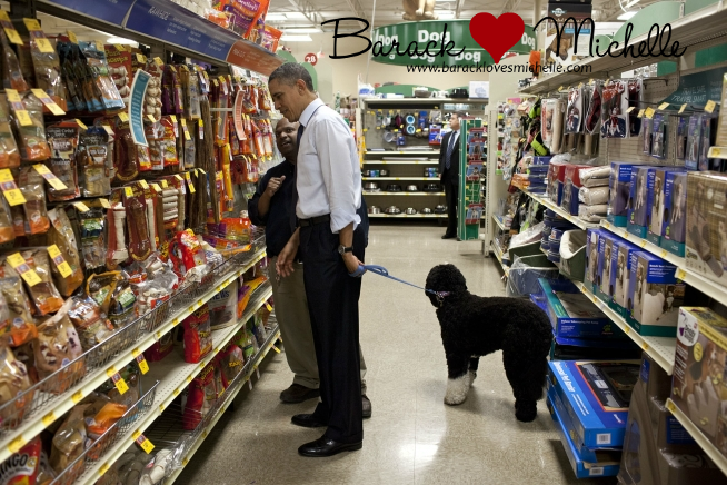 With an employee as he selects a bone for bo the obama family dog