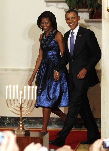 U.S. President Barack Obama and first lady Michelle Obama arrive for a Hanukkah reception at the White House in Washington