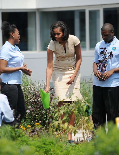 US First Lady Michelle Obama helps to wa