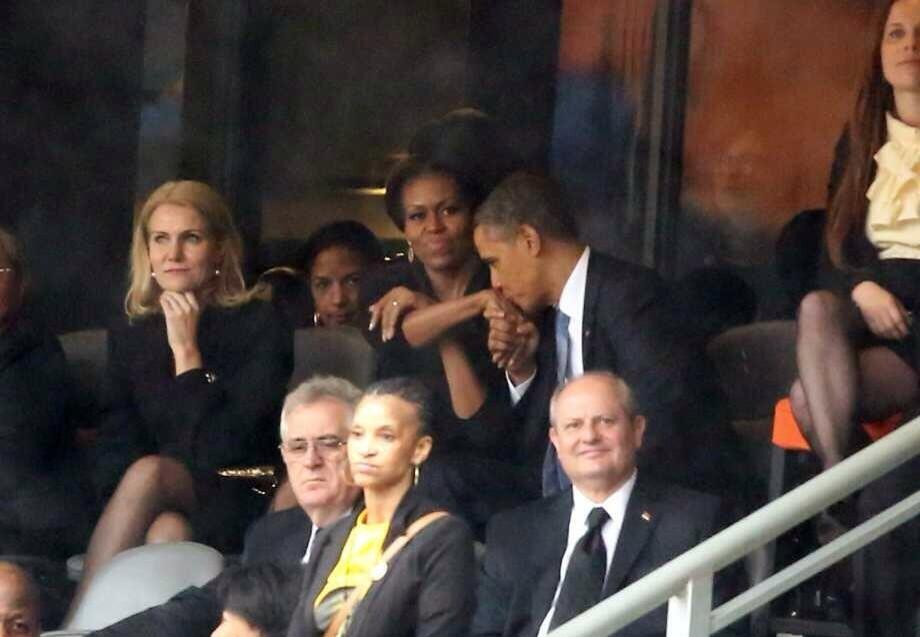 president obama kisses first ladys hand