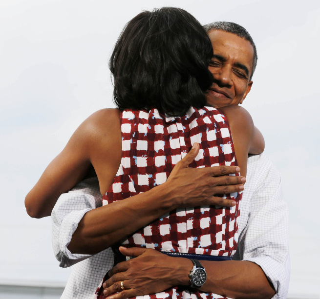 Image: File photo of U.S. President Barack Obama hugging the first lady at campaign event in Davenport, Iowa