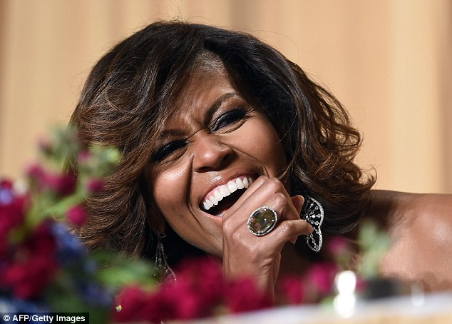 michelle obama laughing dinner