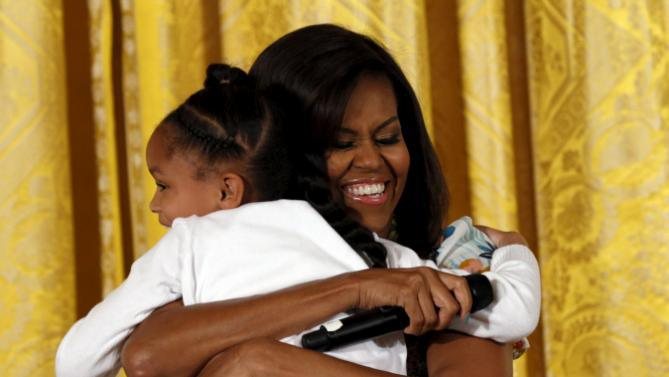 """Michelle Obama hugs Anaya during the White House's annual """"Take Our Sons and Daughters to Work Day"""" in Washington"""