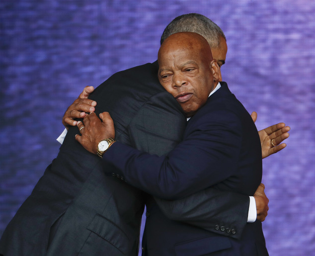 Rep. John Lewis, D-Ga., right, and President Barack Obama embrace at the dedication ceremony for the Smithsonian Museum of African American History and Culture on the National Mall in Washington, Saturday, Sept. 24, 2016. (AP Photo/Pablo Martinez Monsivais)
